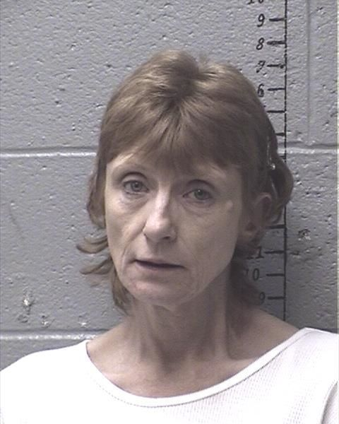 Woman charged in murder