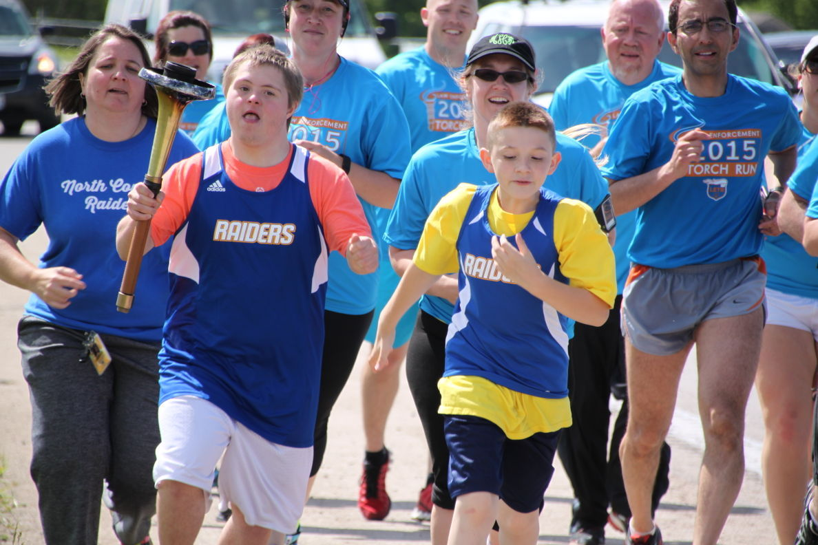 Young athletes join law enforcement for annual torch run