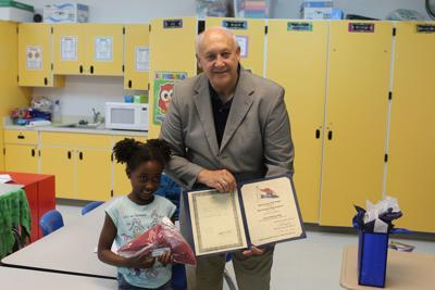 Coloring book contest winner honored - 2