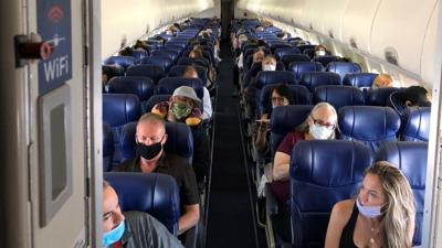 Masked passengers fill a Southwest Airlines flight from Burbank to Las Vegas in June of 2020, with middle seats left open.
