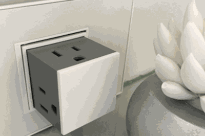 This Sleek Pop Up Outlet Lets You Plug In Three Cords At Once
