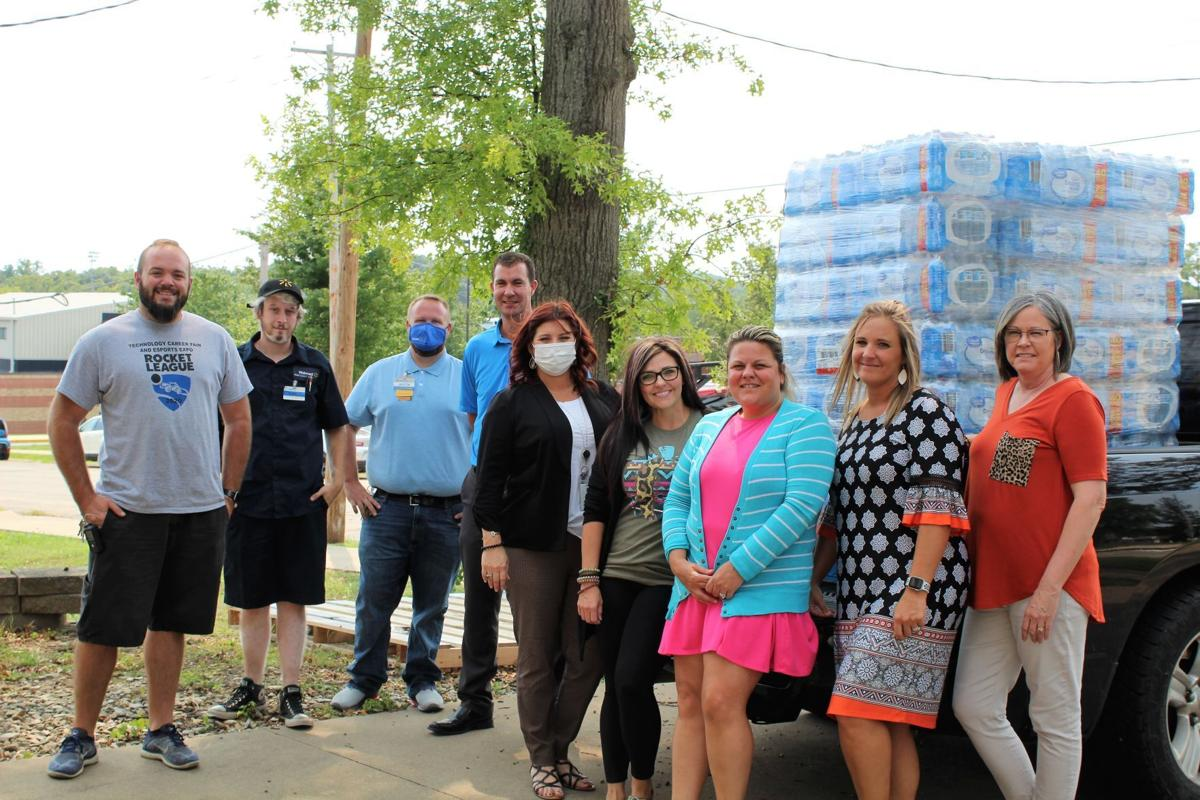 Cedarhurst donates water bottles to Central students