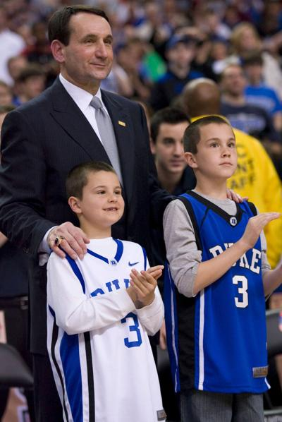 In March 2009, Duke head coach Mike Krzwzewski and his grandsons Michael Savarino, left, then age 8, and Joey Savarino, then 9, watch the Blue Devils cut down the nets after capturing the ACC Tournament at the Georgia Dome in Atlanta.