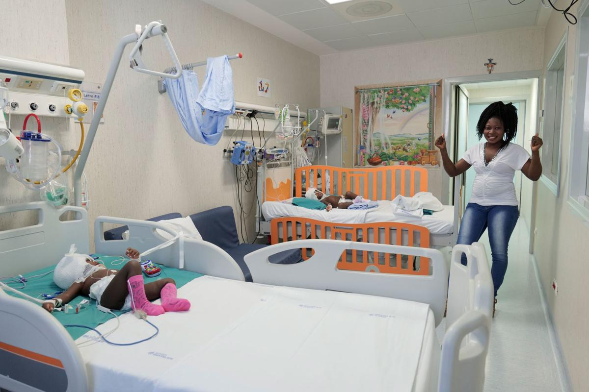 Twin girls, joined at the skull, successfully separated in 18-hour operation in Vatican hospital