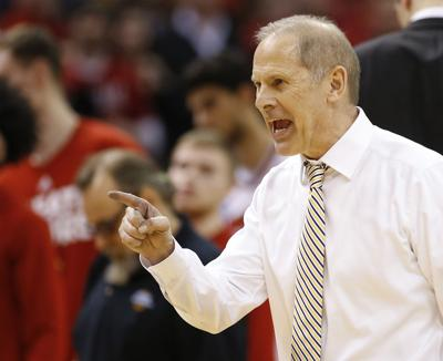 Michigan Wolverines head coach John Beilein reacts to a win over Louisville in the second round of the NCAA men's college basketball tournament on Sunday, March 19, 2017, in Indianapolis, Ind. Beilein is leaving Michigan to coach the Cavaliers in the NBA.