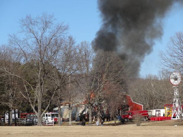 Fire departments battle large barn fire off U.S. 67.jpg