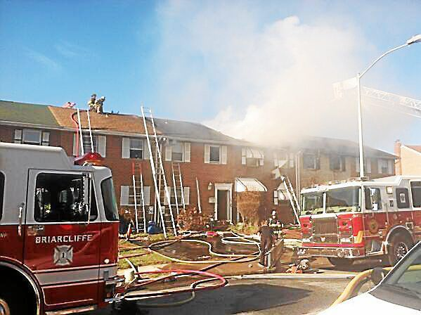 Three-alarm fire roars through homes in Darby Township (With Video)
