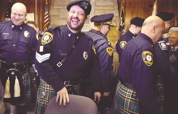 For police pipers, performances are often sad, but honored duty