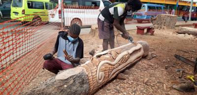 Traditional carvings out of chopped sea oak trees