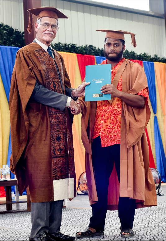 Graduate being awarded his certificate
