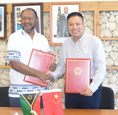 PM Salwai and Chinese Ambassador Liu Quan sign agreement for China to fund athletes to train in China