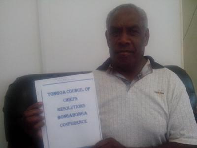 Chief Mariasi with copy of the resolutions