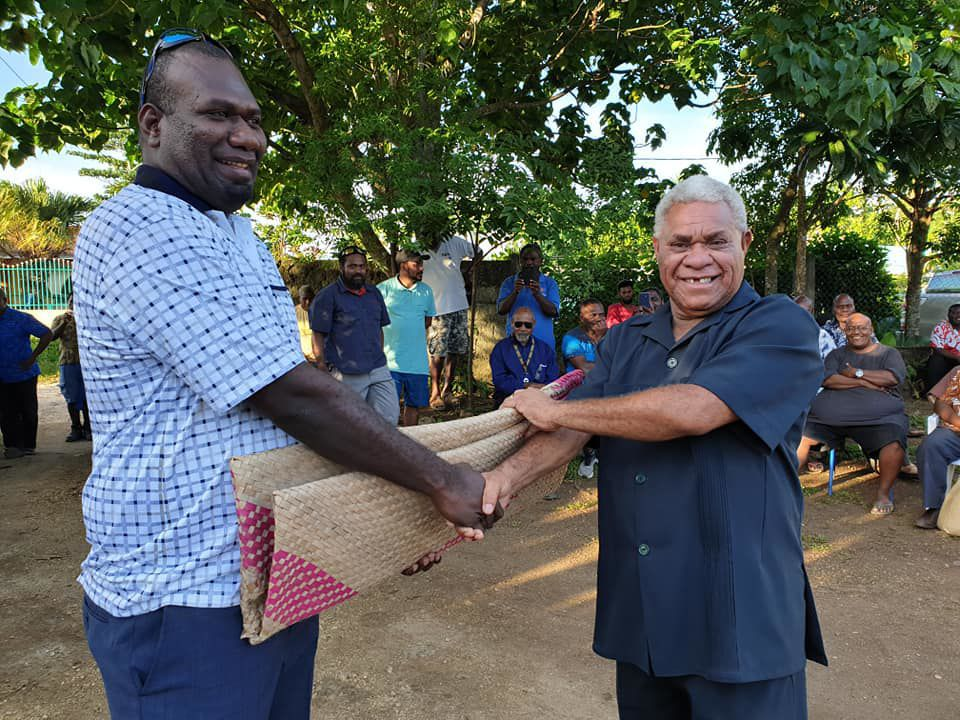 Luganville MP Marc Ati (left) presenting VP President with a mat