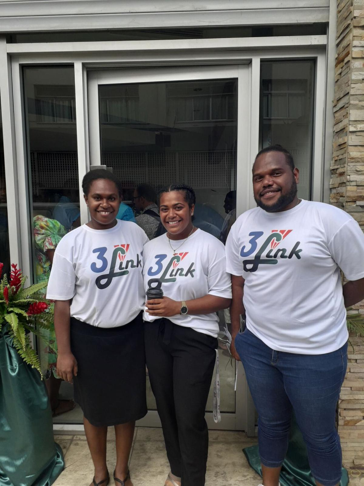 3 Link staff welcoming people to their grand opening