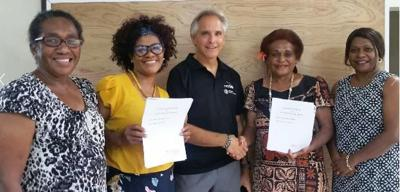 Netball New Zealand PSP Program Coordinator Ivan Harre (center) poses with Vanuatu Netball Association board members after the signing ceremony. Photo: Kathie Simons