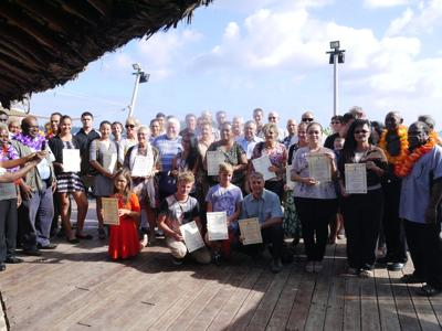 One hundred new citizens receive their citizenship certificate
