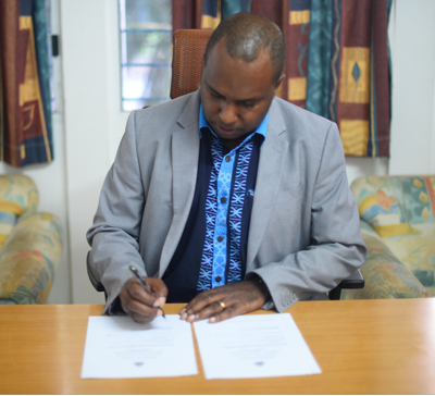 Minister Napuat Signs Increase in Minimum Wages
