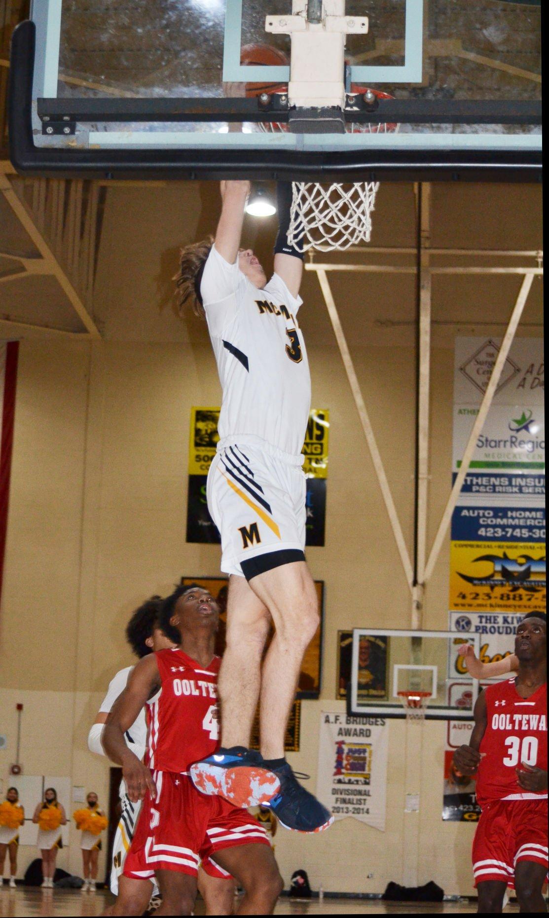 MAIN – McMinn's Parker Bebb rises for the dunk