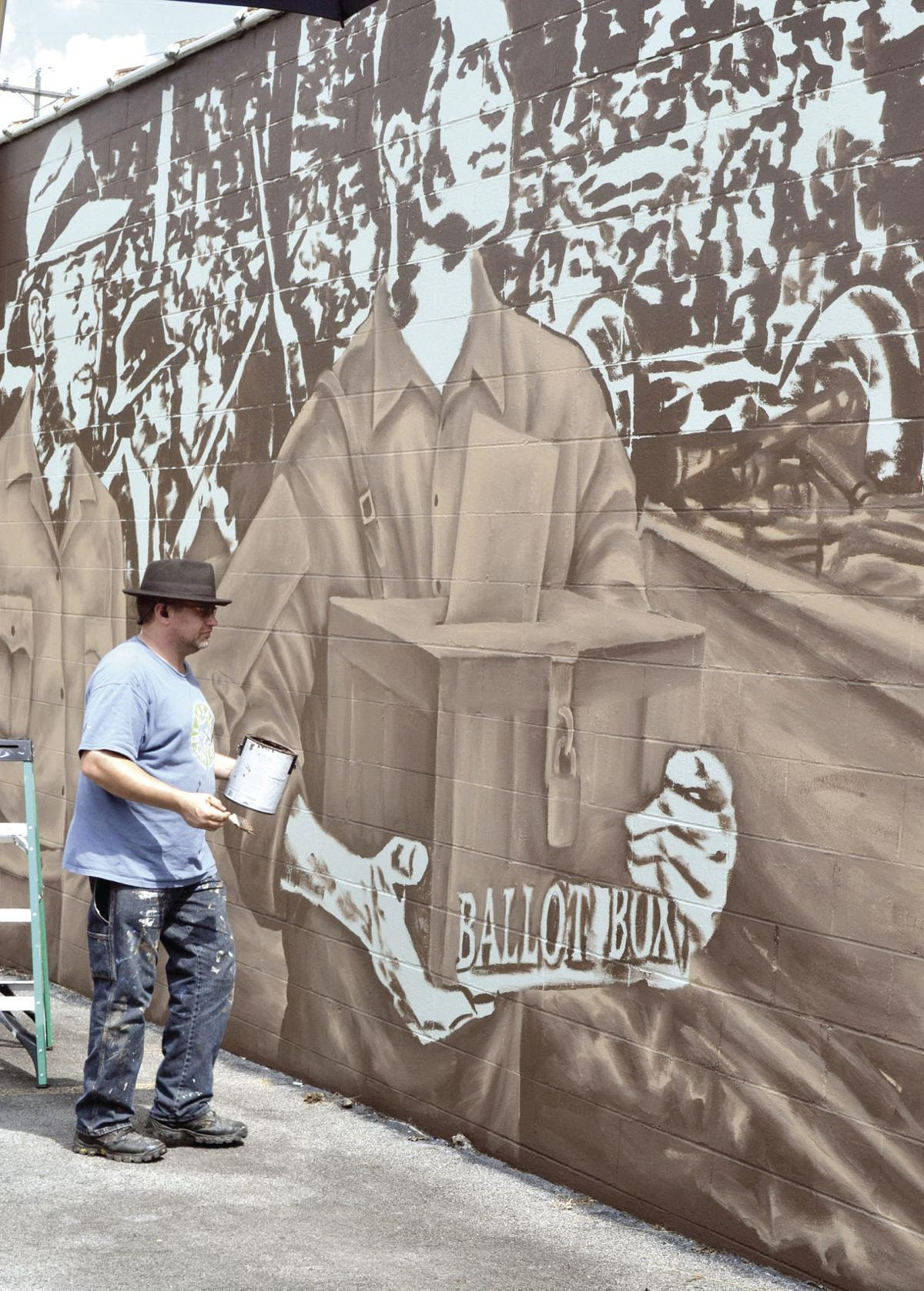 Muralist hopes to inspire deeper thought into what 'Battle' means