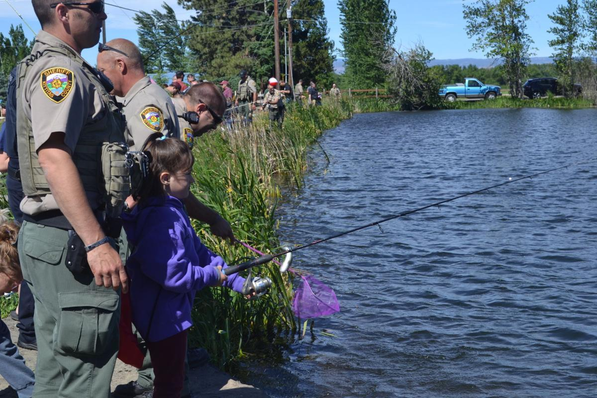 Fish with a Cop catches on in first year: Event draws more than 260 kids