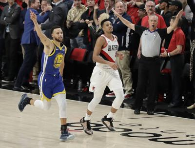 1773039a3 Warriors beat Blazers 119-117 in OT for NBA Finals berth