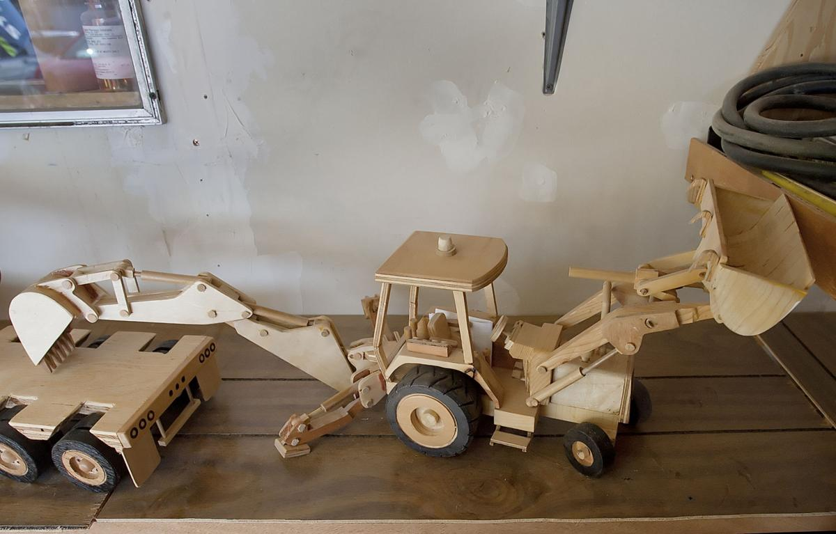 local man builds wooden toy trucks and tractors | members