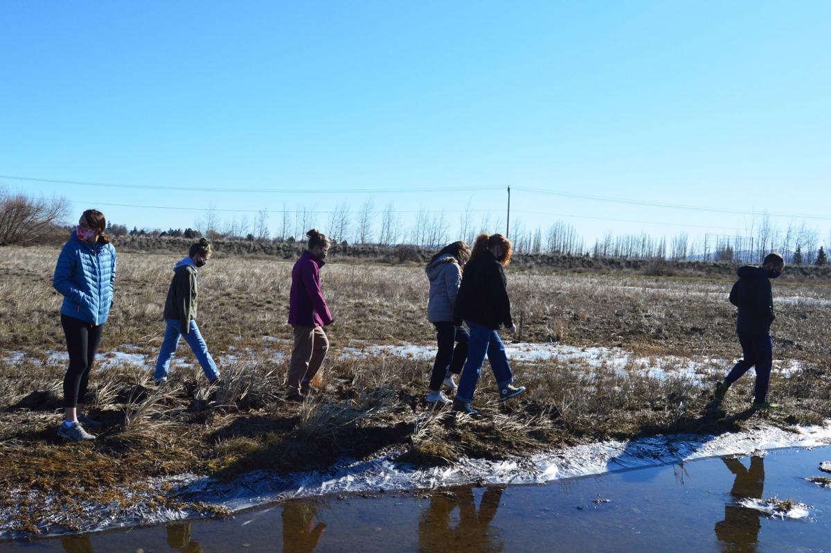 EHS club members get their hands dirty building trails in Reecer Creek floodplain restoration area