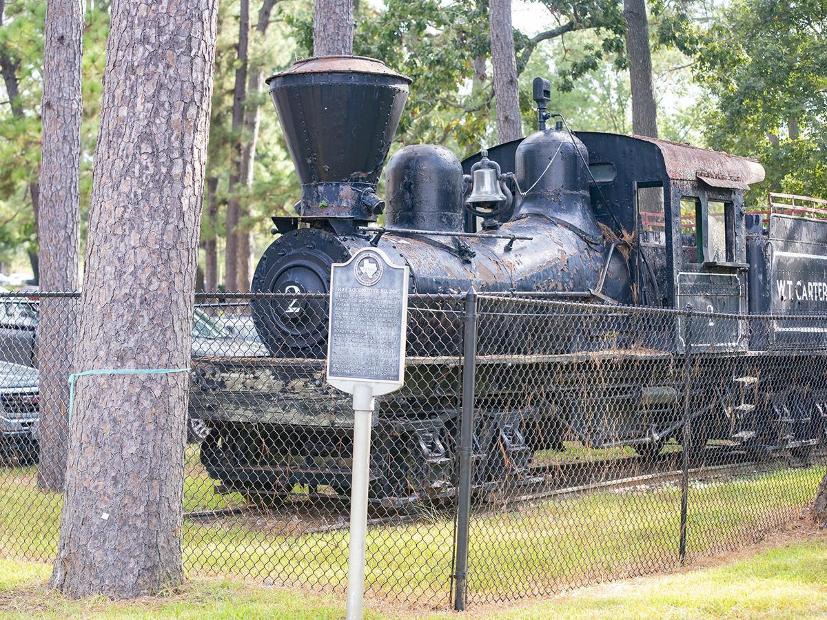 Locomotive, log car leaving SFA