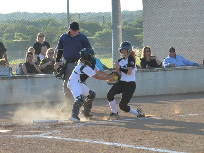 Harper catcher tags #14 Mckenzie Daily as she trys to steal home