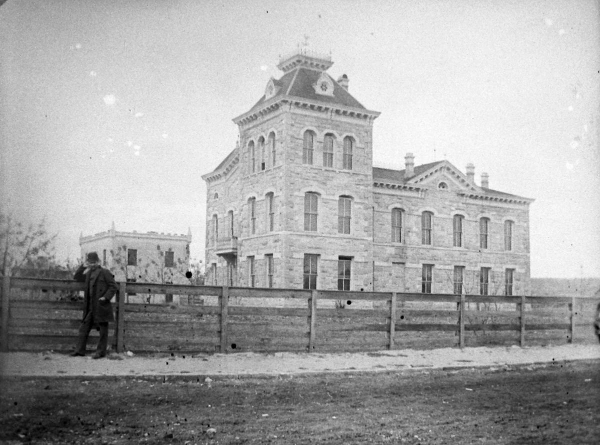 1876 courthouse on left, 1886 courthouse at right