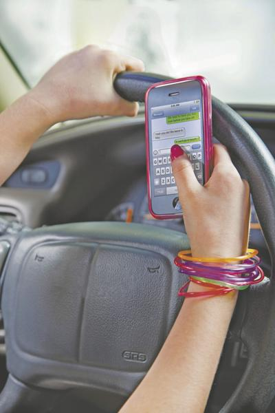 (AP) Texting while driving