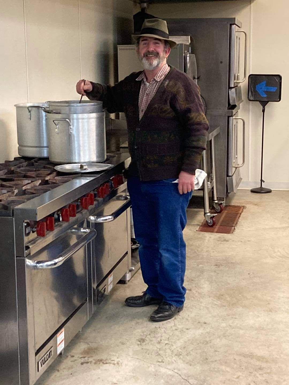 Calvary Temple volunteer prepares a meal