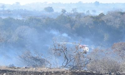 Multiple agencies battle brush fire 10 miles south of Kerrville