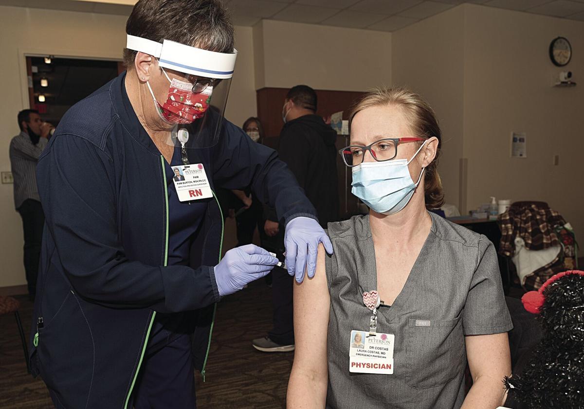 Laura Costas receives her COVID-19 vaccine