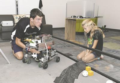 Local students demonstrate their robots at Schreiner event
