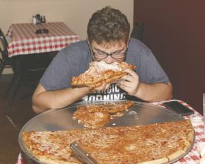 Wesling attempts the pizza challenge