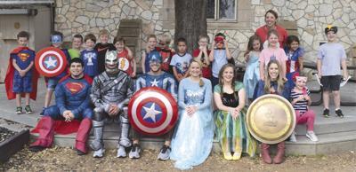 Kids get visit from 'superheroes'