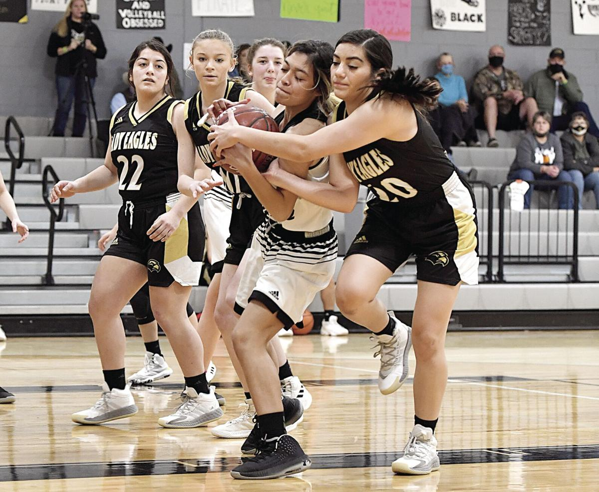 #20 Jasmine Carlos fights for an offensivve rebound Tuesday night against the Junction Lady Eagles