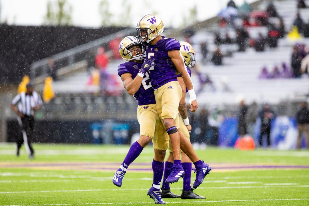 Family time: Trent McDuffie finds a home away from home with UW football