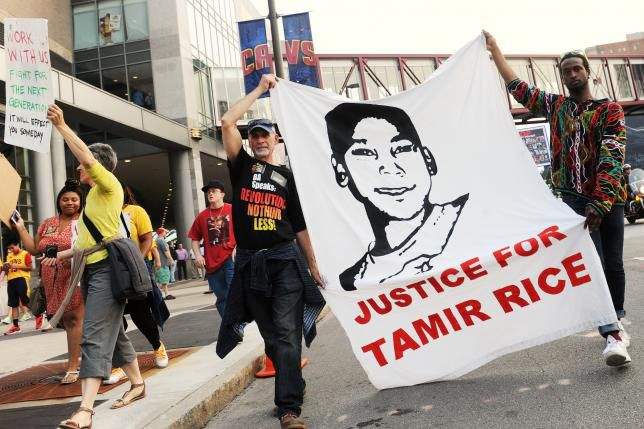 Tadar Muhammad and Jeremy Brustein demonstrate in support of Tamir Rice