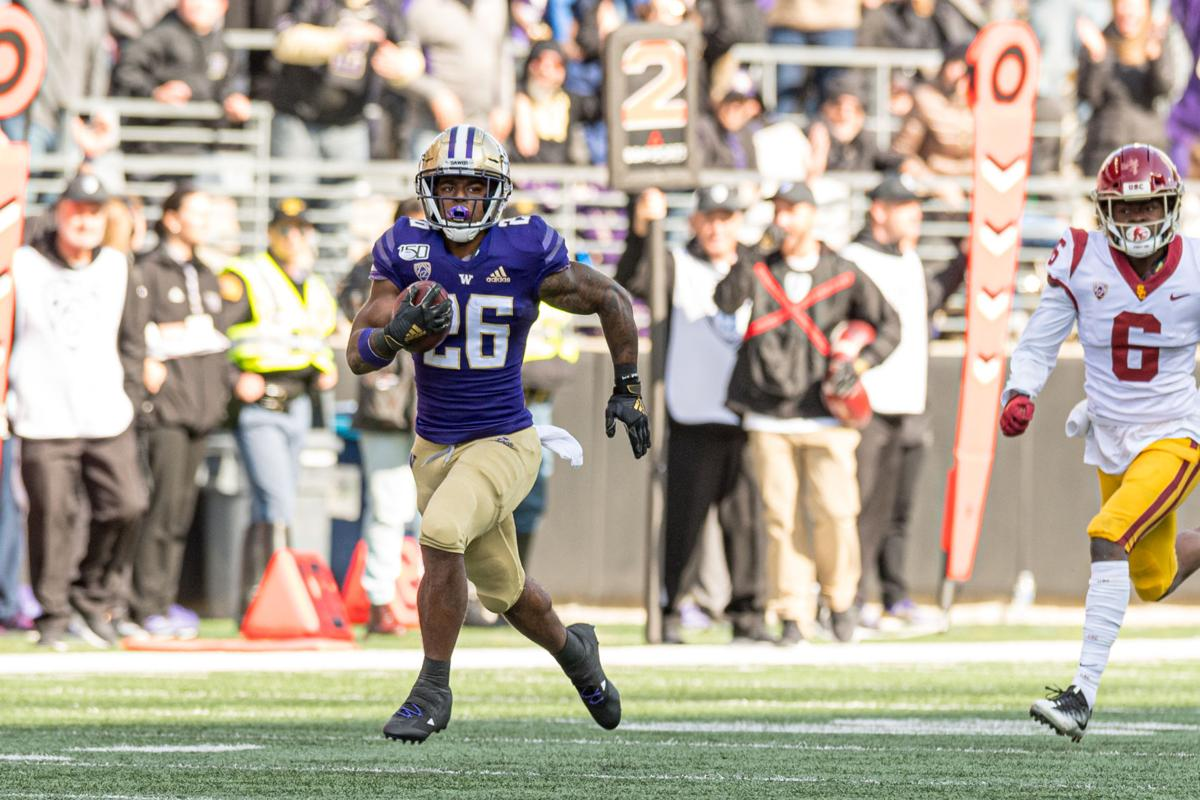 Huskies slow down Trojan offense in first conference win