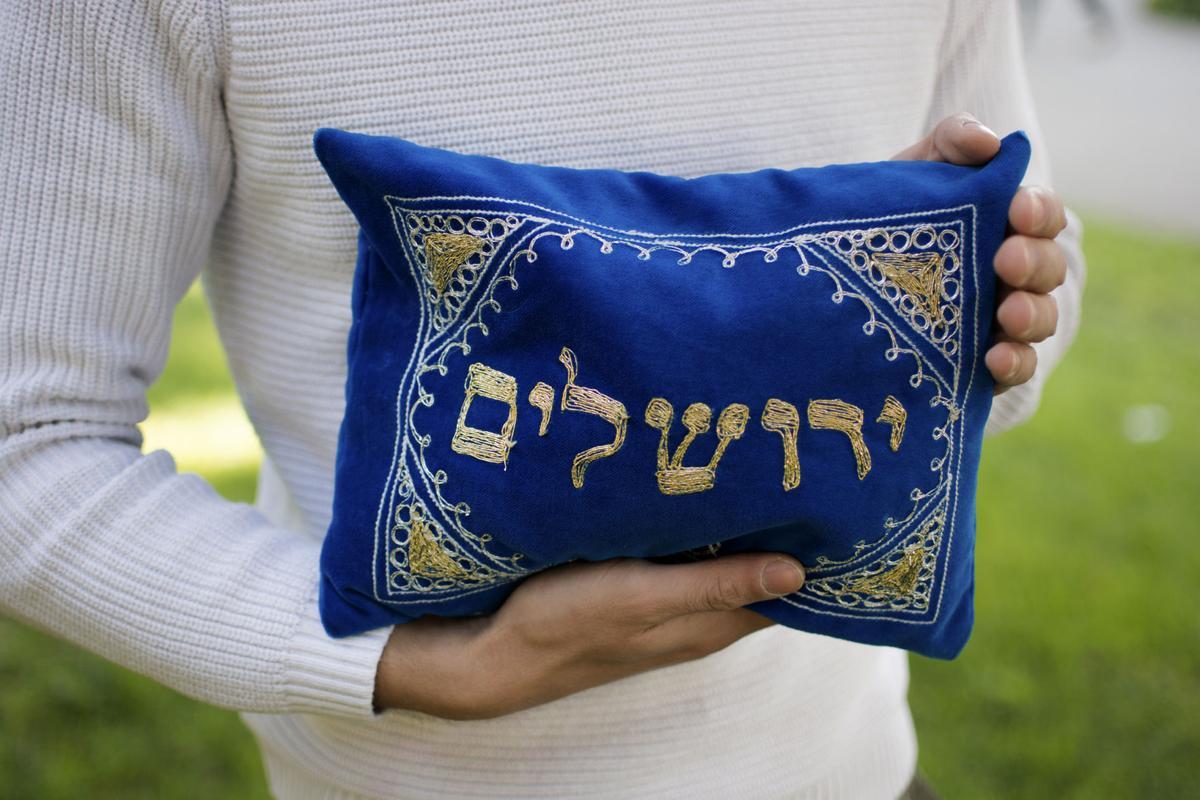 Noah Genatossio holding pillow