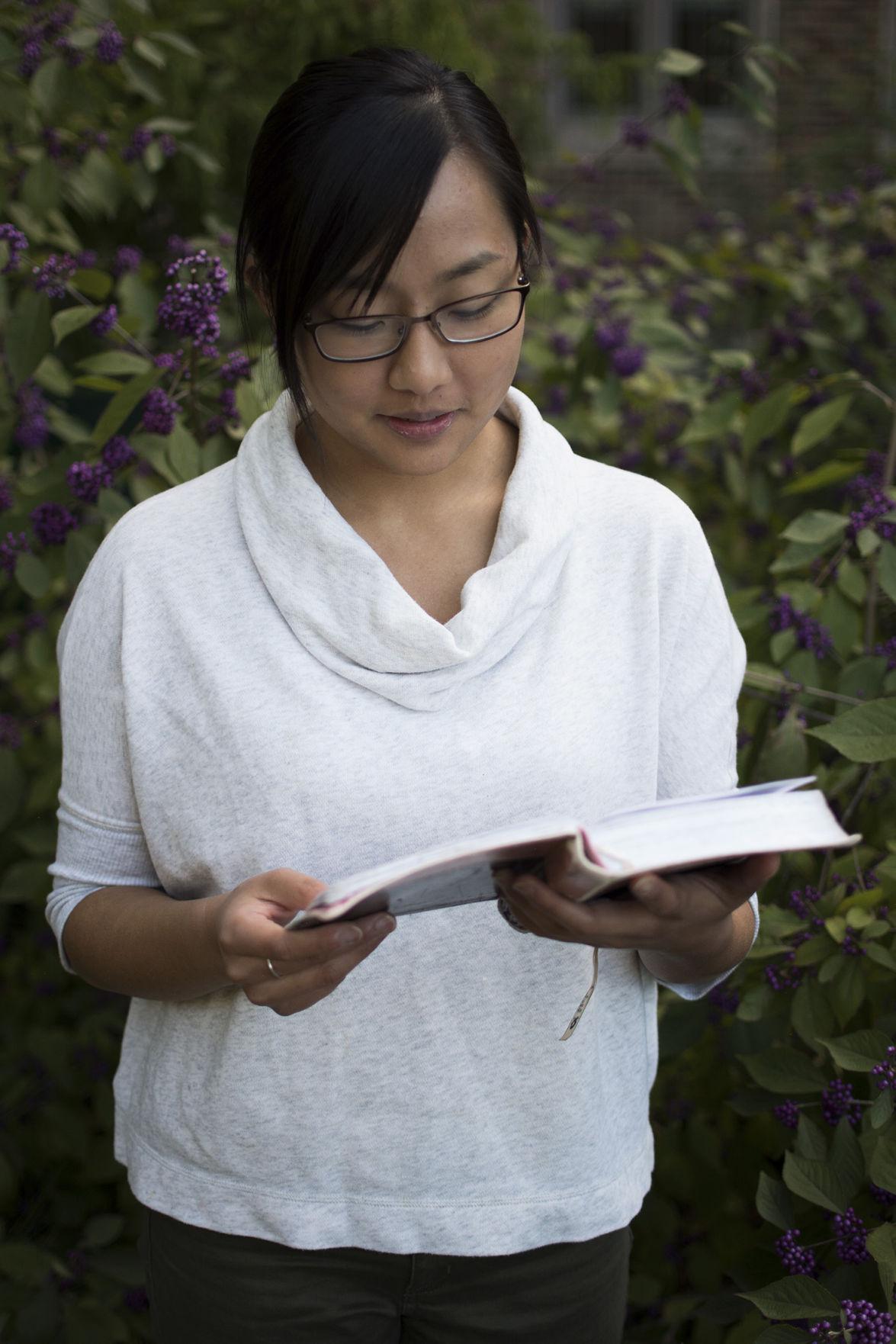Stella Lao holding bible