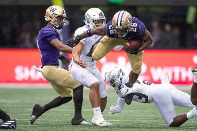 UW run game has to keep going against the toughest the Pac-12 has to offer