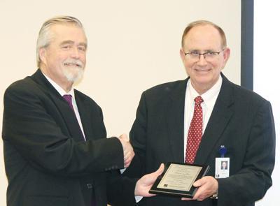Bill Bruce receives congratulations from Tom Gustafson