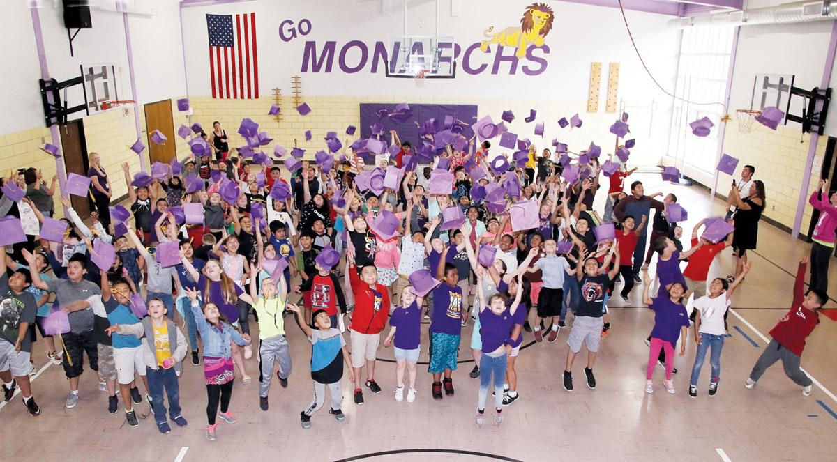 Denison Elementary third graders graduation cap toss