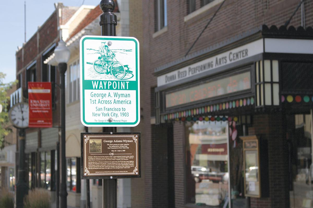 Waypoint sign and memorial plaque of George A. Wyman journey