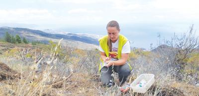 Jazlyn Beeck collects soil gas samples from Mount Teide in the Canary Islands.