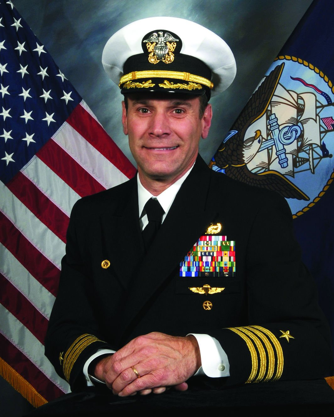 Capt. Todd M. Siddall,  Commanding Officer