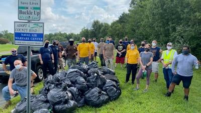 NAWCAD Sailors clear trash from community roadside